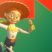 Toy Story Jessie running in front of a large green arrow